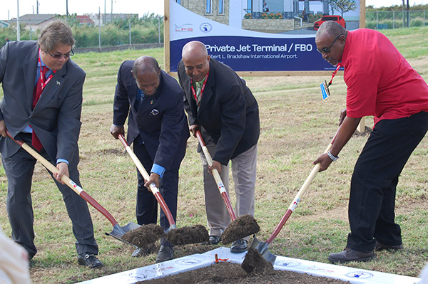 Director, Mr. Uday Nayak; St. Kitts and Nevis' Prime Minister the Rt. Hon. Dr. Denzil L. Douglas; Chairman of the St. Christopher Air and Sea Ports (SCASPA), Mr. Carol Evelyn and Contractor Mr. Lennox  Warner breaking ground at the Robert Llewellyn Bradshaw International Airport. (Photo by Erasmus Williams)